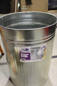 A metal garbage bin